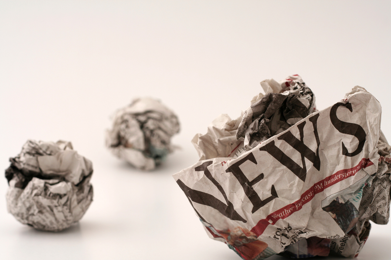 ball of generic newspapers with the word NEWS visible