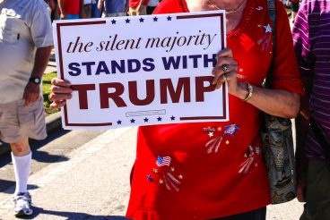 Donald Trump supporter holding pro-trump poster